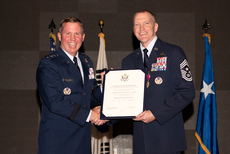 Lt. Gen. Thomas Bergeson, U.S. Central Command deputy commander and former Seventh Air Force commander, poses with Chief Master Sgt. Scott Lumpkin, Seventh Air Force command chief, during his retirment ceremony Nov. 16, 2018 at Osan Air Base, Republic of Korea. During his 30 years in the Air Force, Lumpkin served at 17 different locations which included four assignments to Osan. (U.S. Air Force photo by Senior Airman Kelsey Tucker)