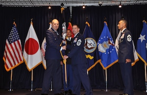 Chief Master Sgt. Terrence Greene (right), who served dual-hatted as the U.S. Forces Japan Senior Enlisted Leader and 5th Air Force Command Chief, relinquished his responsibilities to Chief Master Sgt. Richard. Winegardner Jr., who will serve as the USFJ SEL. USFJ and 5th AF commander Lt. Gen. Jerry Martinez (left) presided over the Change of Responsibility ceremony. This is the first time a senior enlisted leader will serve in each position.