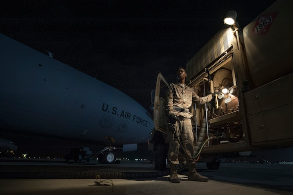 Airman 1st Class Christen Curry, 379th Expeditionary Logistics Readiness Squadron fuels distribution operator, refuels a KC-135 Stratotanker Nov. 28, 2018, at Al Udeid Air Base, Qatar.