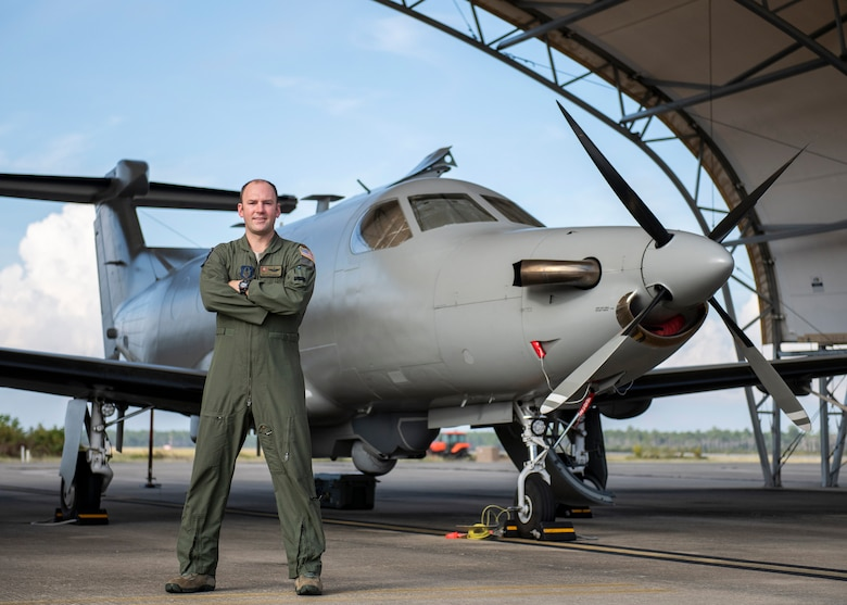 Maj. Kevin Riegner, 5th Special Operations Squadron pilot, takes a few minutes for a photo prior to a recent U-28 training mission at Hurlburt Field, Florida.