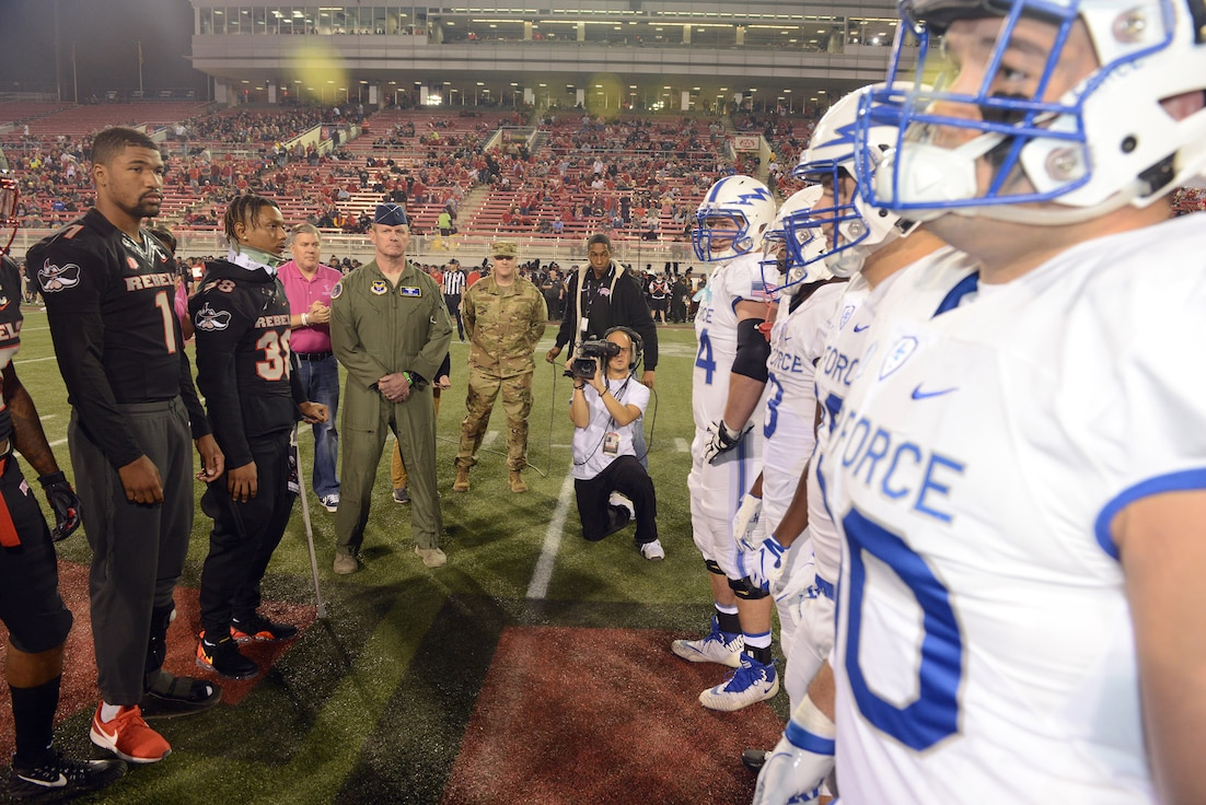 Air Force Reserve Brig. Gen. Christian Funk serves as the honorary captain for the Air Force Academy during a recent Falcons football game. To his left is Chief Master Sgt. Michael Johnson, Air Force Reserve Command Recruiting Service chief of advertising. AFRC RS is getting the message out about the benefits of joining the Reserve at a host of sporting events.