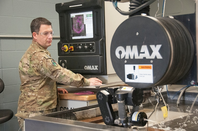 Tech. Sgt. Michael Resseguie, 919th Special Operations Maintenance Squadron, manufactures washers for the C-146A Wolfhound on the OMAX Jetmachining Center at Duke Field, Florida. The 919th SOMXS provides round-the-clock maintenance support for the 919th SOW's global mission.