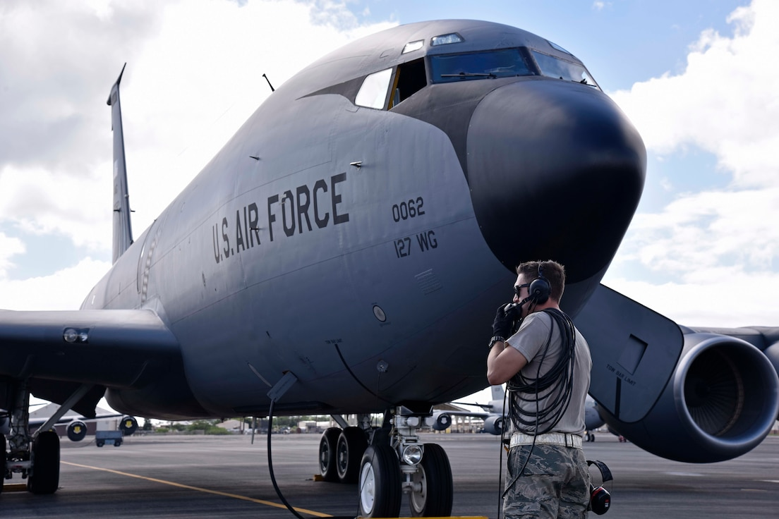 Airman 1st Class Nathaniel Sanchez, a crew chief with the Hawaii Air National Guard's 154th Air Refueling Wing, prepares to service a KC-135 Stratotanker from the Michigan Air National Guard's 127th Wing at Joint Base Pearl Harbor Hickam, Hawaii, Nov. 5, 2018.