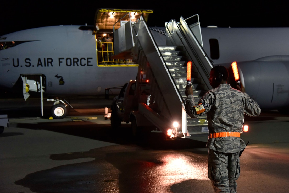 Air stairs are backed away from a KC-135 Stratotanker prior to an early evening take-off at Joint Base Pearl Harbor Hickam, Hawaii, Nov, 9, 2018.