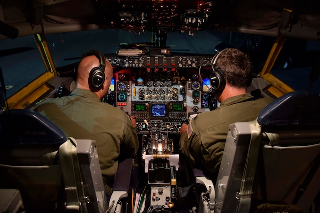 Two 171st Air Refueling Squadron pilots run through their pre-flight check-list aboard a KC-135 Stratotanker prior to an early evening take-off at Joint Base Pearl Harbor Hickam, Hawaii, Nov, 9, 2018.