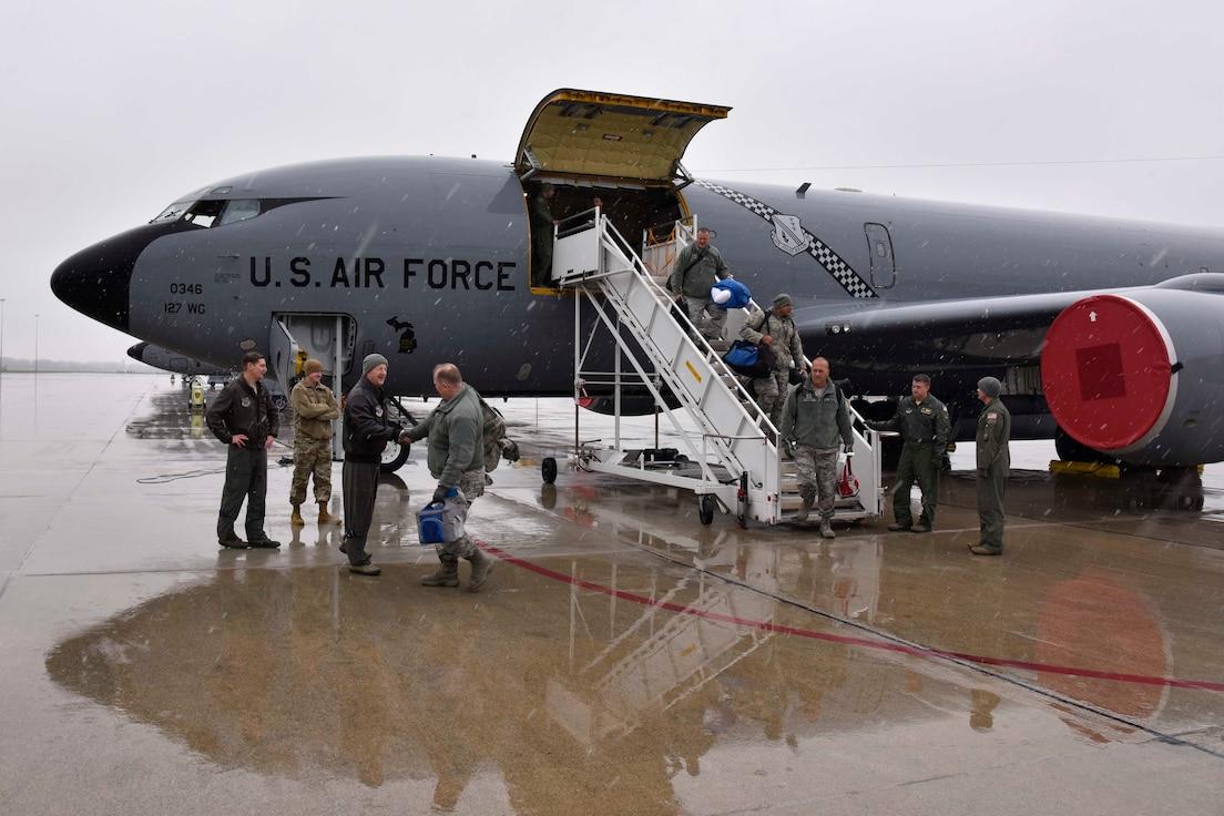 Citizen-Airmen of the Michigan Air National Guard disembark from a KC-135 Stratotanker at Selfridge Air National Guard Base, Mich., Nov. 9, 2018.