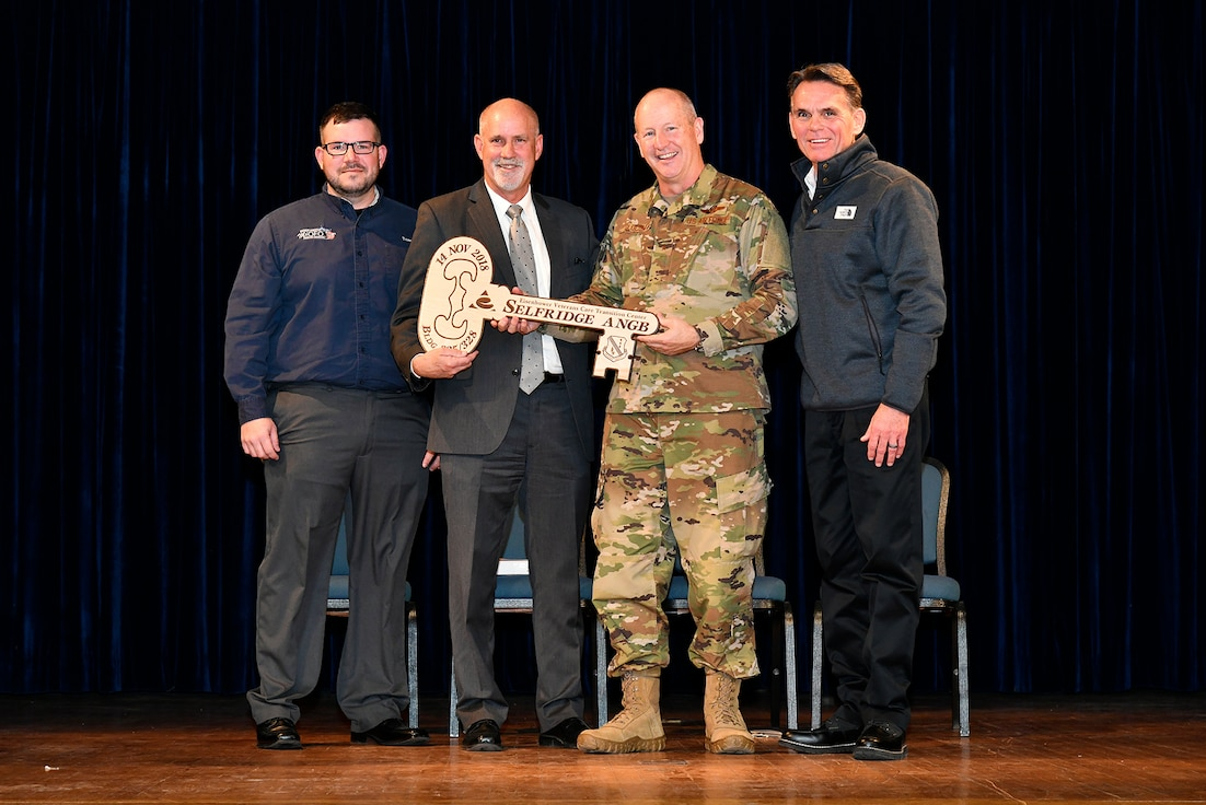 "Tom Jones, a former Eisenhower patient, Brig. Gen. John D. Slocum, commander of Selfridge Air National Guard Base, John Cornack, C.E.O. of the Eisenhower Center and Mark Hackel, Macomb County Executive, celebrate the ceremonial key-passing during a ceremony here on November 14, 2018. The ""Eisenhower Veteran Care Transition Center"" will provide a residential rehabilitation and reintegration program, ultimately capable of servicing 42 veteran patients suffering from service-related conditions, specifically post-traumatic stress disorder, mild-to-moderate traumatic brain injury or chronic traumatic encephalopathy."