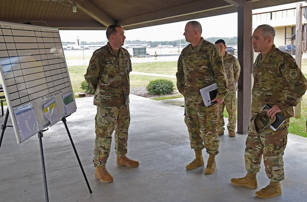 Maj. John R. Gordy II, U.S. Air Force Expeditionary Center commander and Command Chief Master Sgt. Kristopher K. Berg, USAF EC command chief, meet with an Airman from the 43rd Air Mobility Operations Group at Pope Army Airfield Nov.20, 2018. (U.S. Air Force photo by Tech. Sgt Jamie Powell)