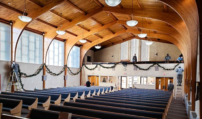 Airmen in training decorate the base chapel with holiday garland at Sheppard Air Force Base, Texas, Nov. 22, 2018. The Airmen participated in Operation Thanksgiving Traditions, a new event created by chapel staff to help Airmen feel at home during the holiday. (Courtesy photo)
