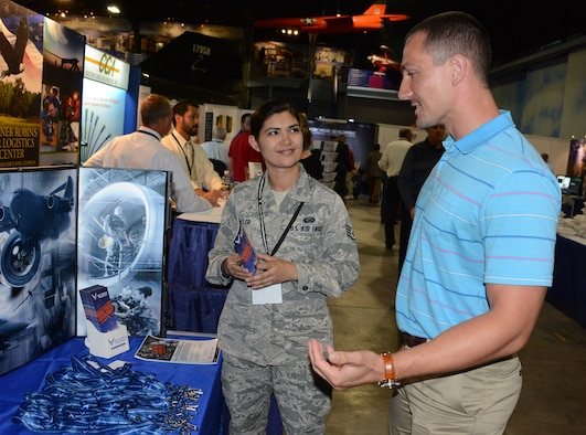 Staff Sgt. Kristine Butler, a recruiter with the 94th Airlift Wing, Dobbins Air Reserve Base, Georgia, talks to a perspective recruit at a trade show.