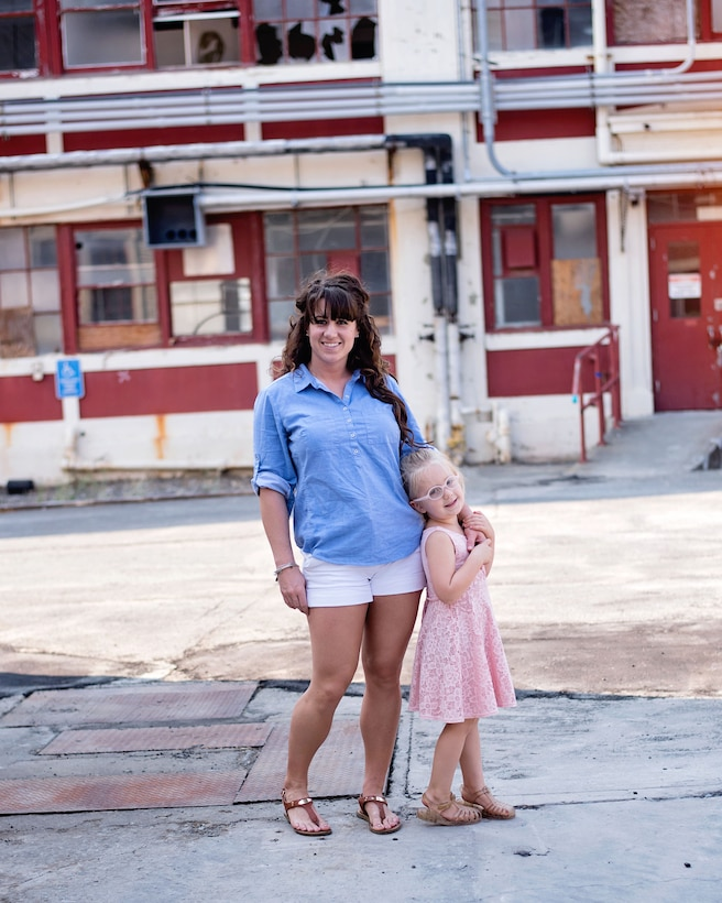 U.S. Air Force Staff Sgt. Amanda Scheer, 60th Contracting Squadron contracting specialist, and her daughter, Paisley, pose for a photo in Vallejo, California., Aug. 20, 2017. Scheer is a single mother and has served in the Air Force for six years. (Courtesy photo by Valerie Ozella)
