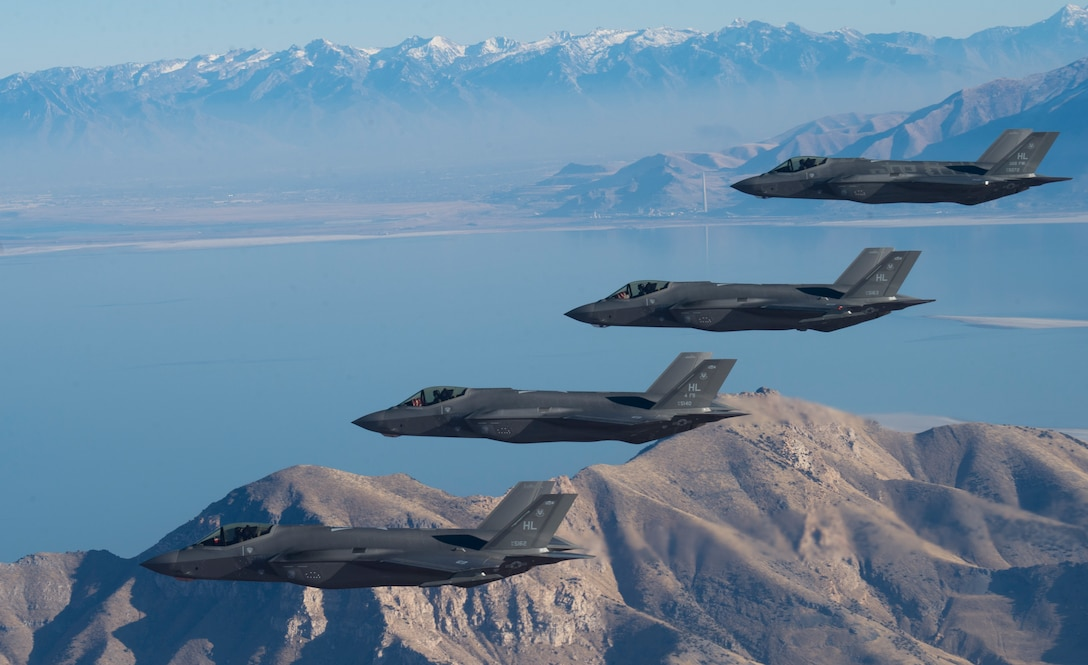 A formation of F-35 Lightning IIs from the 388th and 419th Fighter Wings stationed at Hill Air Force Base perform aerial maneuvers during a combat power exercise over Utah Test and Training Range, Nov. 19, 2018.