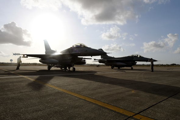 Two F-16 Fighting Falcons from the 149th Fighter Wing, Air National Guard, line the apron at Natal Air Force Base in Natal, Brazil, Nov. 16, 2018.