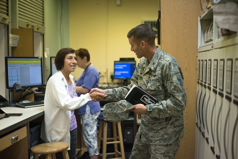 A volunteer at MacDill's Brandon Clinic greets U.S. Air Force Col. Stephen Snelson, 6th Air Mobility Wing Commander, Oct. 11, 2018