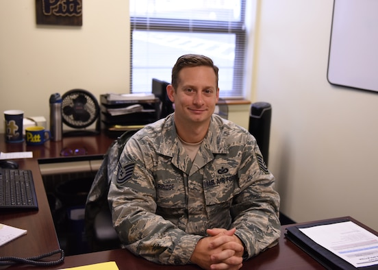 Tech. Sgt. Joseph Bridge, budget analyst with the 911th Financial Management Office, poses for a photo in his office at the Pittsburgh International Airport Air Reserve Station, Pa., Nov. 3, 2018. As a budget analyst, Bridge looks at the legality of finances and watches how all the wing's money is used. (U.S. Air Force photo by Senior Airman Grace Thomson)