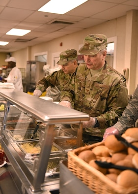 Col. Douglas N. Strawbridge, commander of the 911th Airlift Wing, and Command Chief Master Sgt. Christopher D. Neitzel, command chief of the 911th Airlift, serve food to Airmen at a Thanksgiving lunch at the Pittsburgh International Airport Air Reserve Station, Nov. 3, 2018. Every year the base leadership serve a Thanksgiving lunch to give thanks to the Airmen on the base. (U.S. Air Force photo by Senior Airman Grace Thomson)