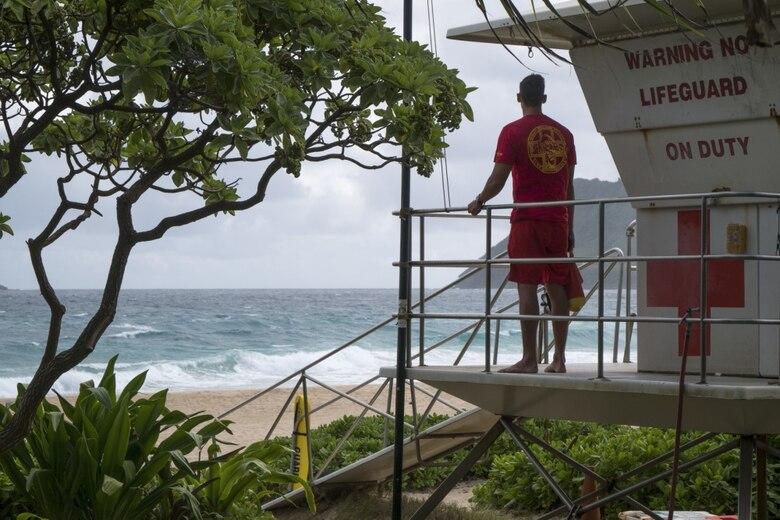 Senior Airman Casey Whitworth, a full-time lifeguard and triage response team member of the Hawaii Air National Guard, monitors Pyramid Beach November 20, at Marine Corpse Base Hawaii.