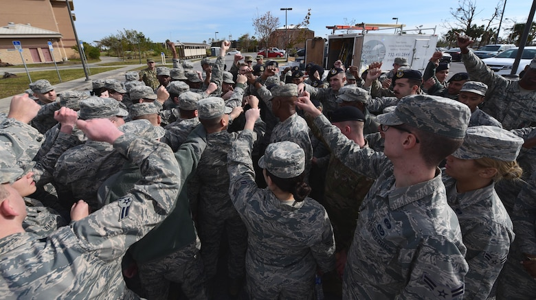 Task Force Talon II Airmen rally around Chief Master Sgt. Craig Williams, 325th Fighter Wing command chief, at Tyndall Air Force Base, Fla., Nov. 28, 2018. Williams spoke to his fellow Airmen on the state of Tyndall now and in the future. Task Force Talon II Airmen are responsible for clearing debris from various parts of Tyndall. (U.S. Air Force photo by Senior Airman Isaiah J. Soliz)