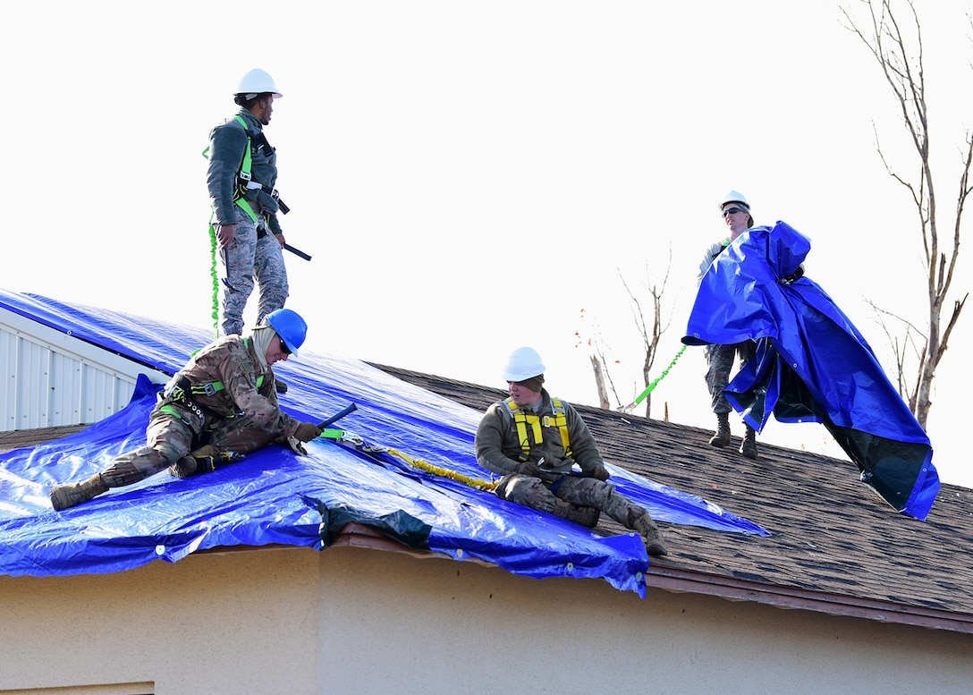 Task Force Phoenix Airmen repair a damaged rooftop at Tyndall Air Force Base, Fla., Nov. 28, 2018. Task Force Phoenix is responsible for large-scale clean up and reconstruction after Hurricane Michael ravaged the 325th Fighter Wing. (U.S. Air Force photo by Senior Airman Isaiah J. Soliz)