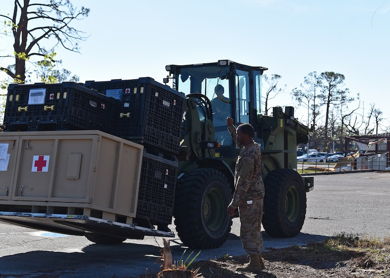 Staff Sgt. Dock Newell, 325th Medical Support Squadron medical material noncommissioned officer in charge, directs Airman Christian Myers, 1st Special Operations Logistics Readiness Squadron vehicle operator, where to stage a pallet of outpatient medical equipment at Tyndall Air Force Base, Fla., Nov. 27, 2018. Large-scale recovery efforts have continued in the weeks since Hurricane Michael struck the Florida panhandle and Tyndall AFB. (U.S. Air Force photo by Senior Airman Isaiah J. Soliz)