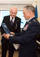 U.S. Air Force Maj. Gen. John Williams, Mobilization Assistant to the commander, U.S. Air Forces in Europe and Africa, presents the U.S. Air Medal to Swedish air force Maj. Krister Sjoberg in Stockholm, Sweden, Nov. 28, 2018. The Swedish pilots were awarded the U.S. Air Medal for their actions on June 29, 1987. (U.S. Air Force Photo by Senior Airman Kelly O'Connor)