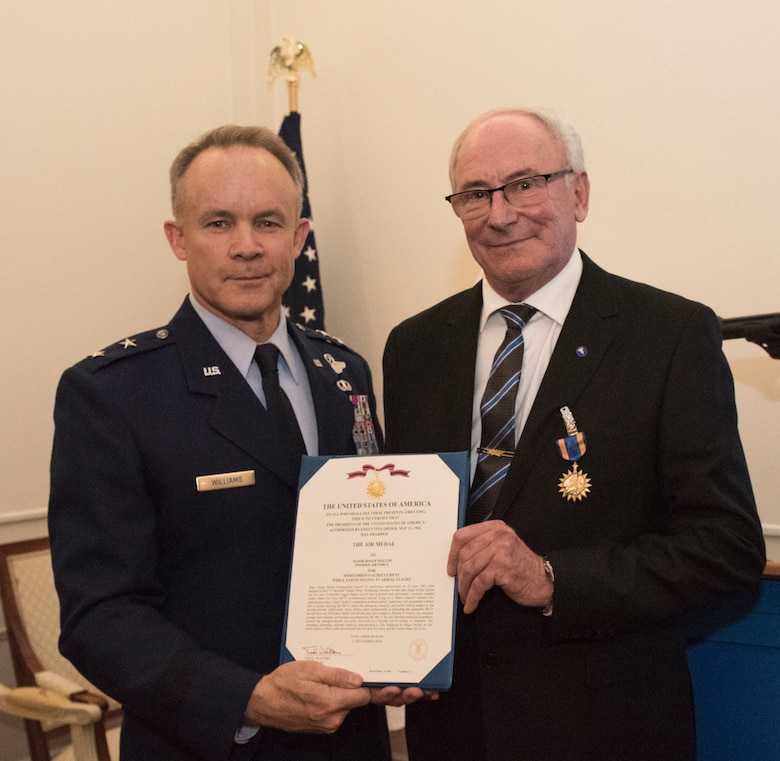 U.S. Air Force Maj. Gen. John Williams, Mobilization Assistant to the commander, U.S. Air Forces in Europe and Africa, presents the U.S. Air Medal to Swedish air force Col. Lars-Erik Blad in Stockholm, Sweden, Nov. 28, 2018. The Swedish pilots were awarded the U.S. Air Medal for their actions on June 29, 1987. (U.S. Air Force Photo by Senior Airman Kelly O'Connor)
