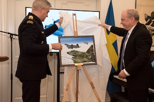 Swedish and U.S. representatives unveil an official portrait of the event which distinguished the four Swedish pilots and earned them their U.S. Air Medals in Stockholm, Sweden, Nov. 28, 2018. The Swedish Airmen risked their lives to save an SR-71 and the aircrew on June 29, 1987. (U.S. Air Force Photo by Senior Airman Kelly O'Connor)