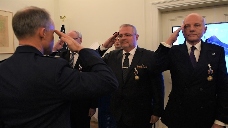U.S. Air Force Maj. Gen. John Williams, Mobilization Assistant to the commander, U.S. Air Forces in Europe and Africa, salutes the Swedish pilots who are being awarded the U.S. Air Medal in Stockholm, Sweden, Nov. 28, 2018. Gen. Williams thanked the four Swedish Airmen who risked their lives to save an SR-71 and the aircrew in 1987. (U.S. Air Force Photo by Senior Airman Kelly O'Connor)