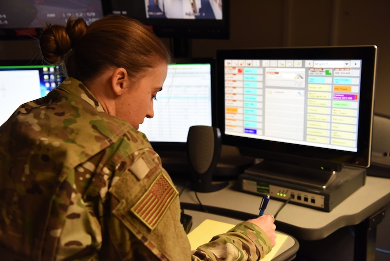 U.S. Air Force Tech. Sgt. Elizabeth Lefaive, 100th Air Refueling Wing Command Post NCO-in-charge of command and control readiness, looks over emergency notification systems in the command post at RAF Mildenhall, England, Nov. 27, 2018. Lefavie, along with Airman 1st Class Kalie Lyons, 100th ARW Command Post emergency action controller, were tasked with keeping information flowing to the appropriate shops and leadership through the day if need arises. (U.S. Air Force photo by Airman 1st Class Brandon Esau)