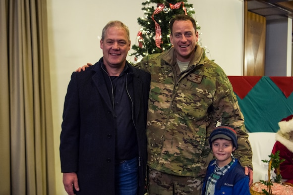 U.S. Air Force Col. Joseph Wenckus, 86th Airlift Wing vice commander, and his son, right, pose for a photo with Ralf Hechler, mayor of the union community of Ramstein-Miesenbach during Ramstein's annual Christmas Tree Lighting Ceremony on Ramstein Air Base, Germany, Nov. 27, 2018. The city of Ramstein-Miesenbach gave Ramstein Air Base the Christmas tree in 2010, to show the ever-growing partnership between the base and the community. (U.S. Air Force photo by Senior Airman Devin M. Rumbaugh)