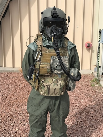 An Airman demonstrates the use of the next-generation chemical, biological, radiological and nuclear protective mask known as the Joint Service Aircrew Mask - Rotary Wing during a test and fielding event.