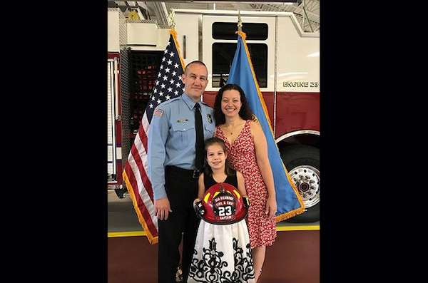 Chris Bales with family at promotion ceremony