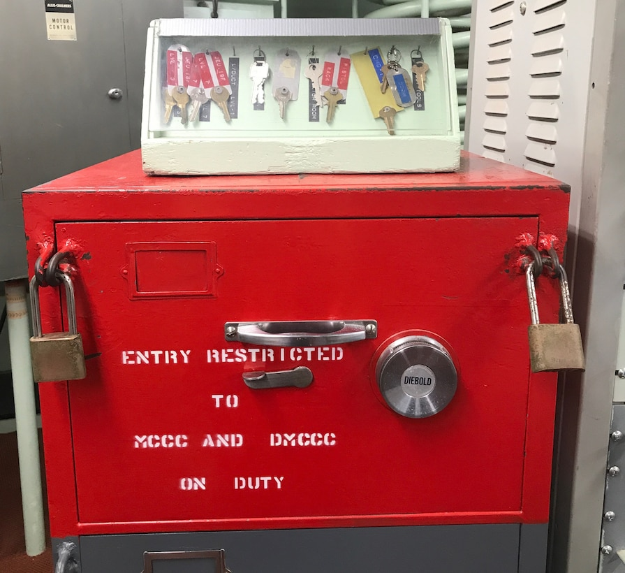 A red padlocked safe inside the launch control center.