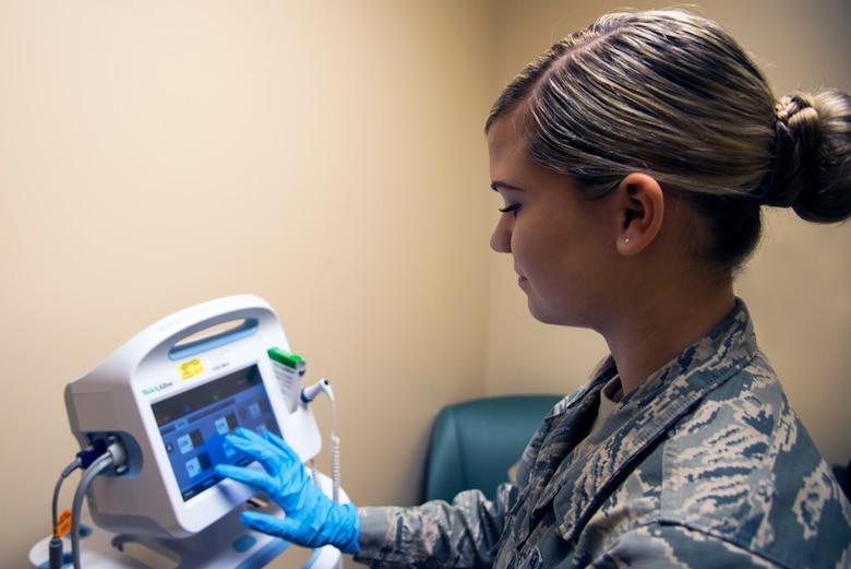 U.S. Air Force Senior Airman Amber Durrence, a 6th Medical Operations Squadron mental health technician, measures a patient's vitals at MacDill Air Force Base, Fla., Nov. 29, 2018.