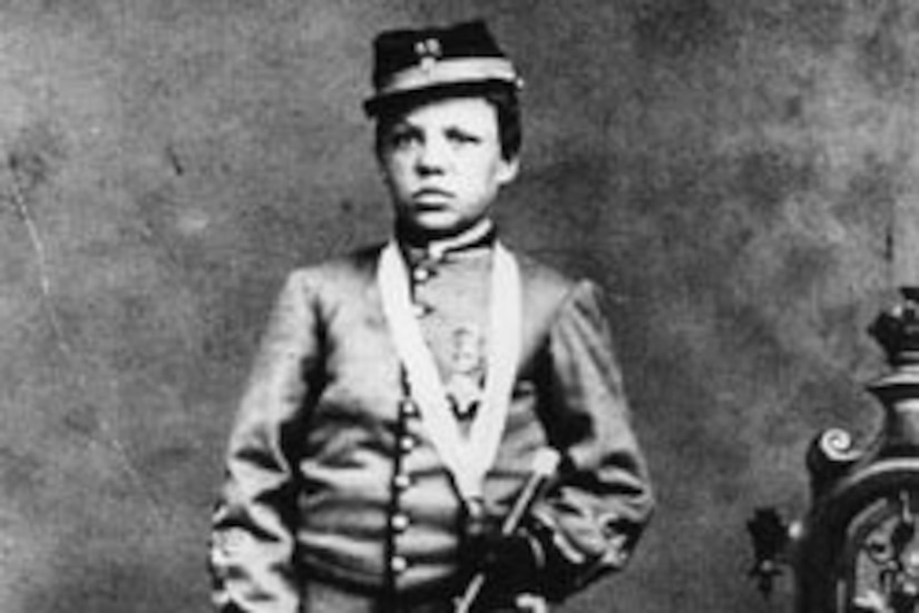 Young boy wearing Union Army uniform holds drum, circa 1861