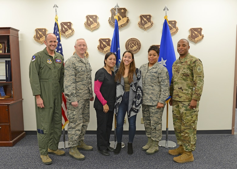 From left to right: Brig. Gen. E. John Teichert, 412th Test Wing commander; Col. Kirk Reagan, 412th TW vice commander; Lorena Rodriguez, 412th Medical Group; Amanda Rodriguez; Senior Master Sgt. Cortney Jones, Desert High School Junior ROTC instructor; and Chief Master Sgt. Roosevelt Jones, 412th TW command chief; pose for a group photo after Amanda learned that Kern County Congressman Kevin McCarthy (R-CA 23rd District) has endorsed her for entry into the U.S. Air Force Academy. (U.S. Air Force photo by Kenji Thuloweit)