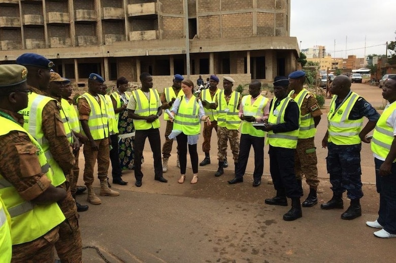 AFOSI Special Agent Helen Marino, center, while assigned to the 25th Expeditionary Field Investigations Squadron, is shown interacting with AFOSI security partners in Burkina Faso. (Photo submitted by SA Helen Marino)