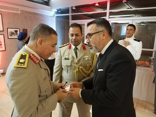 AFOSI Special Agent Jon Maldonado, Special Assistant for International Programs and Government Affairs, exchanges a business card with his Egyptian counterparts. (Photo submitted by SA Jon Maldonado)