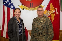 Kristen Johnson, military legislative assistant to Senator Tom Cotton of Arkansas, poses for a picture with Lt. Gen. Robert F. Hedelund, commanding general of II Marine Expeditionary Force at Camp Lejeune, N.C., Nov. 26, 2018. Johnson traveled to Camp Lejeune to observe different elements of the Marine Air-Ground Task Force's expeditionary capabilities and to become familiar with the structure of the United States Marine Corps. (U.S. Marine Corps Photo by Cpl. Taylor W. Cooper)