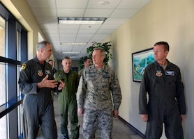 Lt. Gen. R. Scott Williams, 1st Air Force (Air Forces Northern) – Continental U.S. NORAD Region Commander, discusses Gen. Terrence O'Shaughnessy, Commander, Northern American Aerospace Defense Command and U.S.  Northern Command, about 1st Air Force post Hurricane Michael recovery operations during O'Shaughnessy's visit here Nov. 27. Accompanying Williams and O'Shaughnessy (l to r) were BGen Sylvain Menard, CONR deputy commander, and Brig. Gen. Kenneth Ekman, 1st Air Force Vice Commander. During his visit, O'Shaughnessy viewed several 1st AF office facilities undergoing renovations and received a windshield tour of the base. The combatant commander also recognized several superior performers, presenting each his commander's coin for their outstanding efforts to help in the hurricane's aftermath. (Air Force photo by Mary McHale)