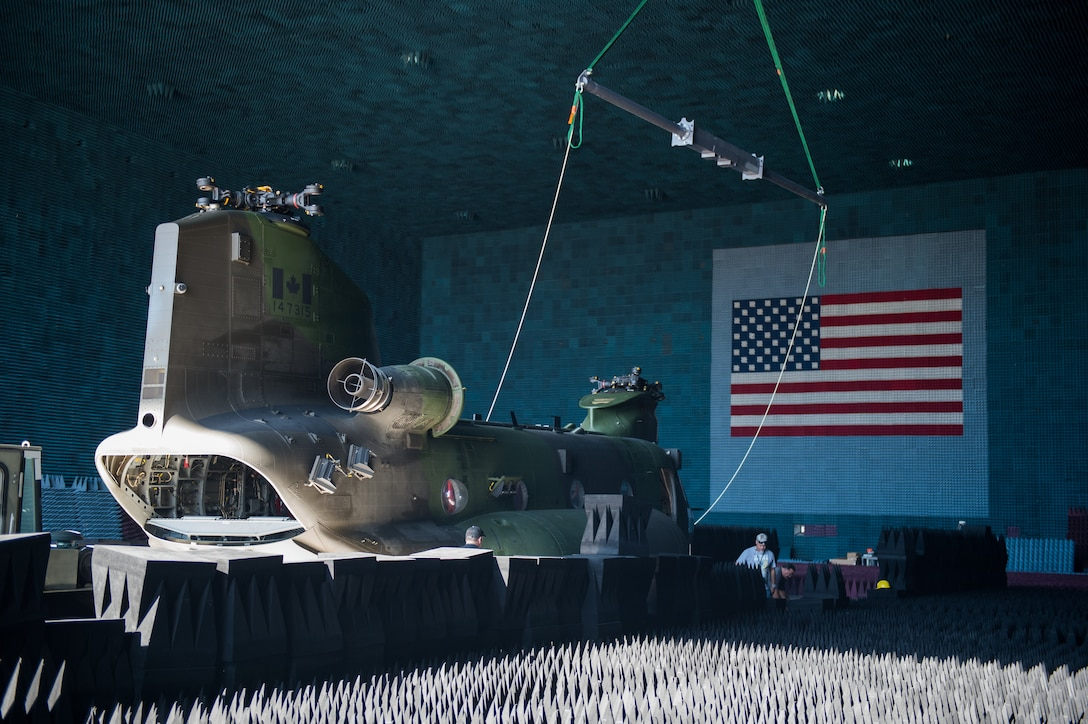 A Royal Canadian Air Force CH-147F Chinook is rolled into the Benefield Anechoic Facility Sept. 24. The BAF, operated by the 772nd Test Squadron, is the largest anechoic chamber in the world and can fit any aircraft inside. The chamber is filled with polyurethane and polyethylene pyramids designed to stop reflections of electromagnetic waves. The size of the pyramids, which are painted dark blue or black, varies depending on the particular frequency and test procedure being conducted. Aircraft systems can be tested and verified that they work properly prior to actual flight test. (U.S. Air Force photo by Kyle Larson)