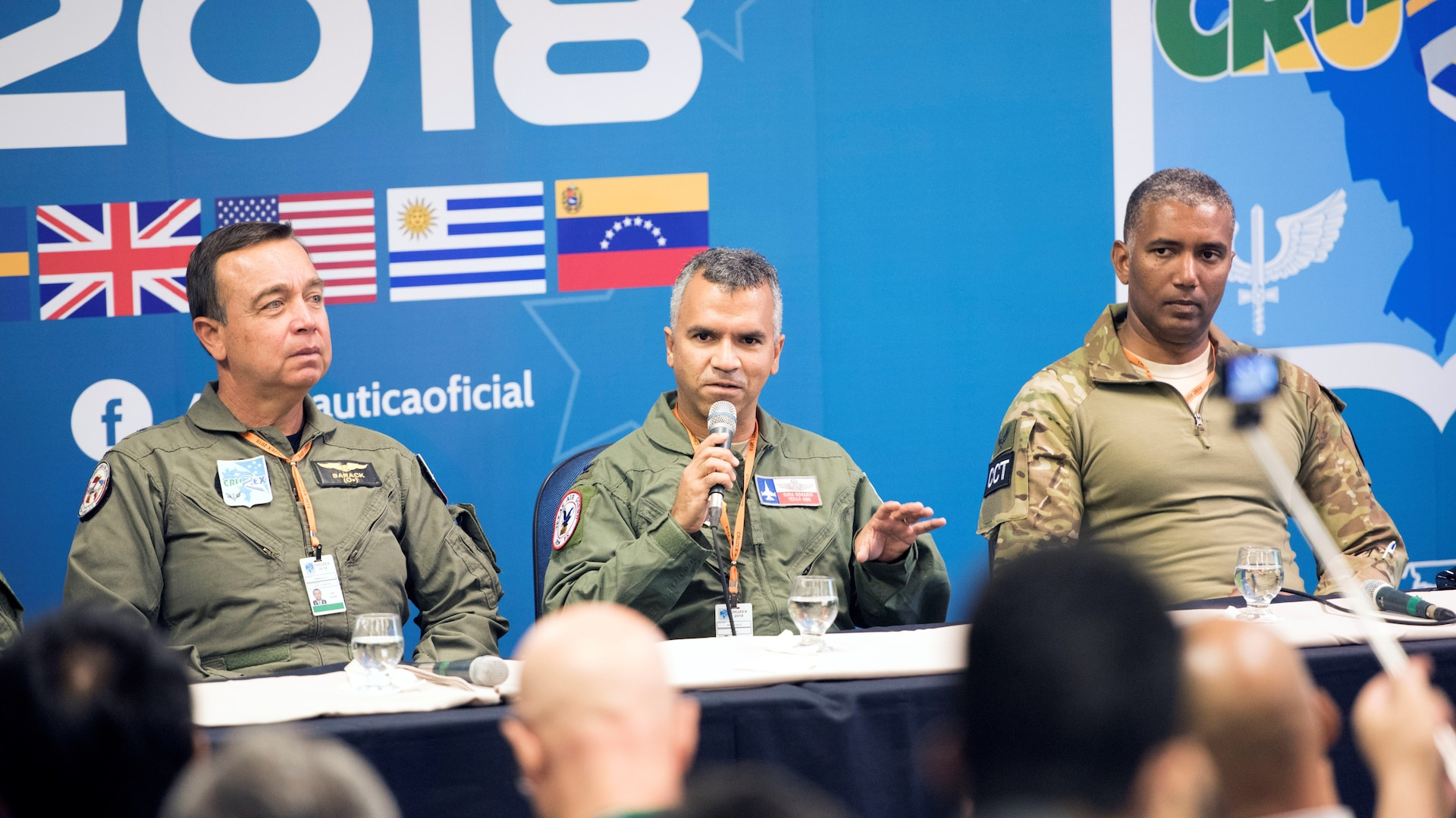 Col. Raul Rosario (center), commander of the 149th Fighter Wing, Air National Guard, participates in an international press panel which included representatives from seven other countries for CRUZEX2018 at Natal Air Force Base, Nov. 19. Approximately 100 international media representatives joined the press conference, hosted by the Brazilian Air Force, to learn about the goals and expectations of the air exercise. The 149th FW commander expressed his gratitude to the host country and for the opportunity to work together as equals to promote peace and safety.