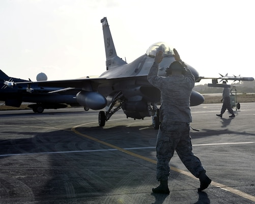 Master Sgt. Jason Willis, assigned to the 149th Maintenance Group, Air National Guard, marshals an F-16 Fighting Falcon onto a Brazilian Air Force apron at Natal, Brazil, Nov. 16, 2018. Members of the 149th Fighter Wing participated in CRUZEX 2018, a multi-national combat air exercise, Nov. 18-30.