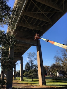 Contractors inspect ongoing repair work of floor beam covers at the St. Georges Bridge in Delaware. Work includes replacement of 45 floor beam covers, more than 7,000 bolts and rivets, and replacement of all deck joint strip seals. Work is expected to be completed around the end of January. St. Georges Bridge was constructed in 1941 and is owned and maintained by the U.S. Army Corps of Engineers.