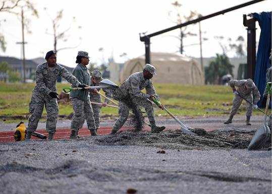 Task Force Talon II Airmen remove gravel from the running track at Tyndall Air Force Base, Fla., Nov. 29, 2018. Task Force Talon II is responsible for clearing debris and cleaning various parts of the base to include parts of the flightline and dormitories. (U.S. Air Force photo by Senior Airman Isaiah J. Soliz)