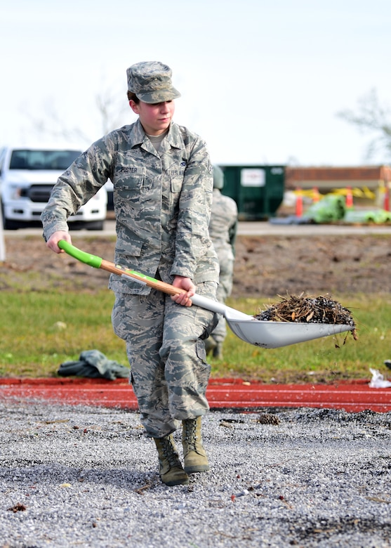 Airman Ashby Foster, Task Force Talon II member, shovels debris from the running track at Tyndall Air Force Base, Fla., Nov. 29, 2018. Task Force Talon II is comprised of Tyndall Airmen and is responsible for clearing debris and cleaning various parts of the base to include parts of the flightline and dormitories. (U.S. Air Force photo by Senior Airman Isaiah J. Soliz)