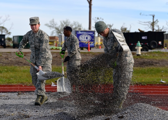 From left to right, Task Force Talon II members Airman Ashby Foster, Airman 1st Class Qwuantez Harris, and Airman Earl Mandle, clear debris from the running track at Tyndall Air Force Base, Fla., Nov. 29, 2018. Task Force Talon II is tasked with clearing debris and cleaning various parts of the base. (U.S. Air Force photo by Senior Airman Isaiah J. Soliz)