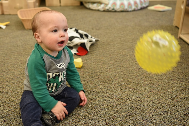 Gunner Sparks, 1, plays with new toys provided by the Child Development Center November 27, 2017, on Grand Forks Air Force Base, North Dakota. The CDC purchased an abundance of toys for each classroom so there are always enough toys for each child. (U.S. Air Force photo by Airman 1st Class Melody Wolff)