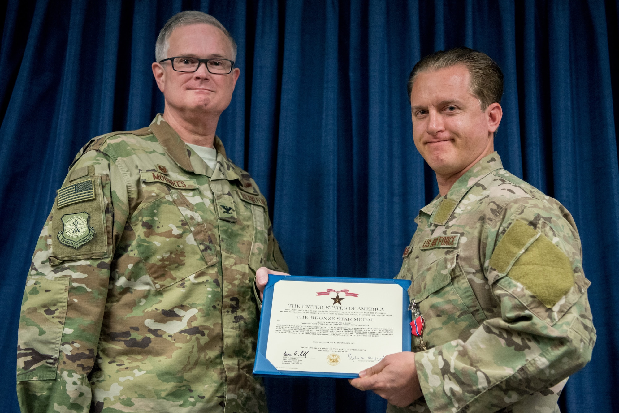 Master Sgt. Blair A. Baerny (right), a pararescueman for the 123rd Airlift Special Tactics Squadron, receives the Bronze Star Medal from Col. David Mounkes, commander of the 123rd Airlift Wing, at the Kentucky Air National Guard Base in Louisville, Ky., Nov. 17, 2018. Baerny distinguished himself for meritorious service with his participation in Operation Freedom's Sentinel from Aug. 22 to Nov. 15, 2015. His leadership ensured effective combat search and rescue coverage for all special operations assets throughout Afghanistan, mitigating risk and maintaining the safety of more than 1,600 personnel. (U.S. Air National Guard photo by Staff Sgt. Joshua Horton)