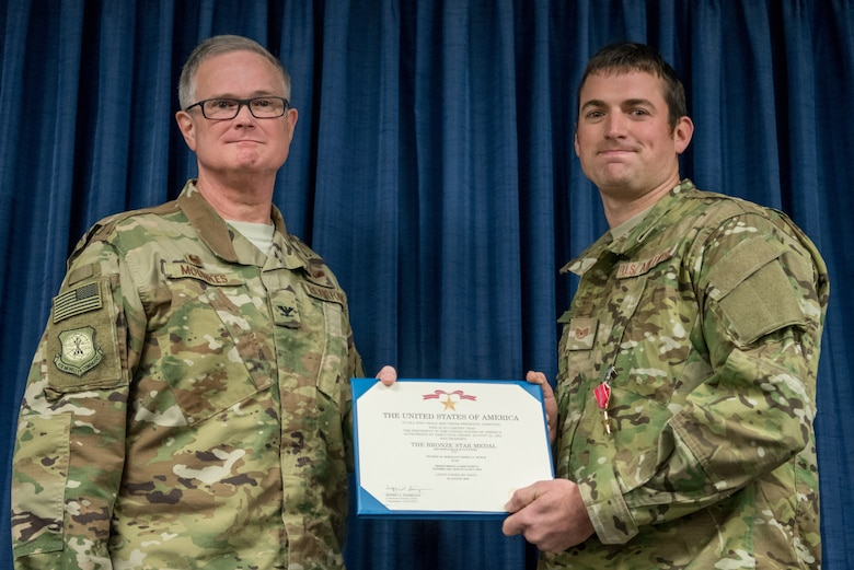 Tech. Sgt. Joshua C. Busch (right), a combat controller for the 123rd Special Tactics Squadron, receives the Bronze Star Medal from Col. David Mounkes, commander of the 123rd Airlift Wing, during a ceremony at the Kentucky Air National Guard Base in Louisville, Ky., Nov. 17, 2018. Busch distinguished himself for meritorious service with his participation in Operations Freedom's Sentinel and Resolute Support. From February to May 2018, Busch served as a key senior tactical advisor for 17 ground combat operations, leading and coordinating 42 air-to-ground engagements while under enemy fire, directly resulting in 33 enemies killed in action. (U.S. Air National Guard photo by Staff Sgt. Joshua Horton)